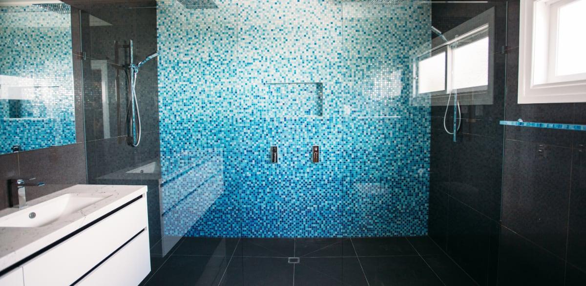 shower head blue tiles