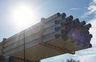 Package of metal pipes in the sunlight