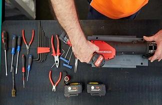 Man servicing tools
