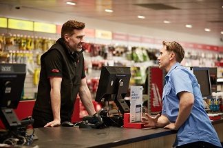 Customer at speaking to a Reece product specialist at a trade counter